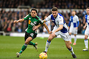Scunthorpe United Midfielder, Duane Holmes (19) and Bristol Rovers Defender, Ryan Sweeney (33) challenge for the ball during the EFL Sky Bet League 1 match between Bristol Rovers and Scunthorpe United at the Memorial Stadium, Bristol, England on 25 February 2017. Photo by Adam Rivers.
