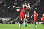 Milton Keynes Dons defender Joe Walsh (4) heads the ball during the EFL Sky Bet League 2 match between Milton Keynes Dons and Grimsby Town FC at stadium:mk, Milton Keynes, England on 21 August 2018.