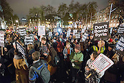 UNITED KINGDOM, London: 01 December 2015 Thousands of people gather in Parliament Square this evening as part of a Stop The War campaign. The emergency protest is being held after Prime Minister David Cameron announced that a vote on UK air strikes in Syria will be held tomorrow. Rick Findler / Story Picture Agency