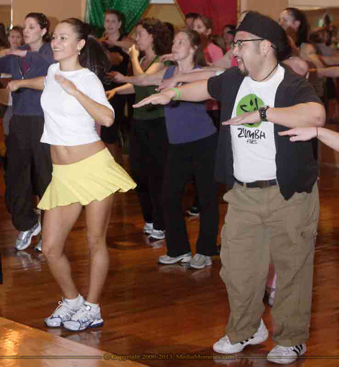 Maria Browning (left, front) and Frank Suarez, both from Lexington participate in the grand opening of Studio Zumba in Vandalia, Sunday, January 28, 2007.