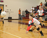 Maquoketa's Aubree Taylor (8) goes for a dig as Erica Sutton (7) looks on during the WaMaC Tournament Championship game at Mount Vernon High School in Mount Vernon on Thursday October 11, 2012. Solon defeated Maquoketa 17-25, 25-15, 15-10.