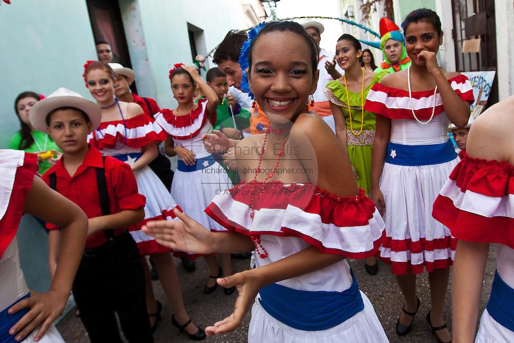 A costumed revelers parade during the Festival of San Sebastian in San Juan, Puerto Rico.