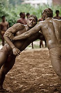 Indian men practicing the ancient sport of Kushti wrestling, Varanasi, India
