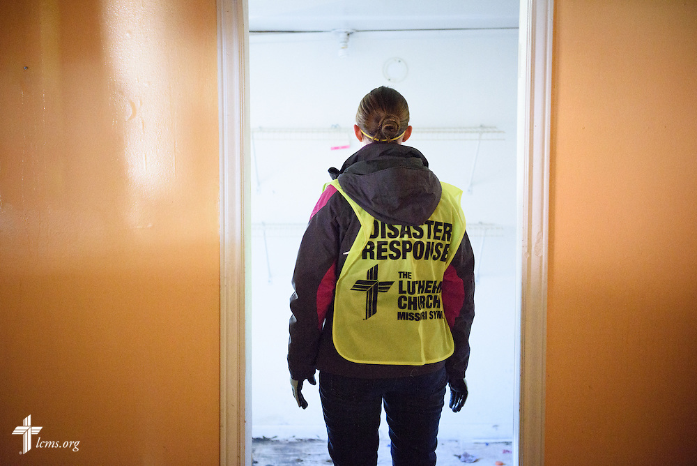 A volunteer from the International Center of The Lutheran Church–Missouri Synod surveys a flooded home during a cleaning event in Fenton on Thursday, Jan. 14, 2016. LCMS Communications/Erik M. Lunsford