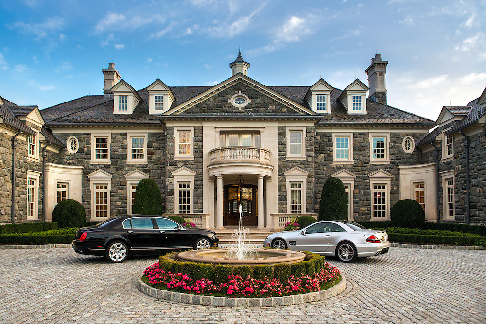 "The ""Stone Mansion"" in Alpine, New Jersey. Built on the historic Frick Estate. The house has 30,000 square feet on five floors, built of solid granite and steel infrastructure, with 12 bedrooms, 19 bathrooms, indoor basketball court, movie theatre, 11-car garages, 4000-bottle wine cellar and elevator."