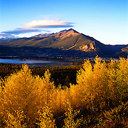 Autumn scenic of Aspen Trees, Lake Dillon, Town of Frisco and Ten Mile Range, CO