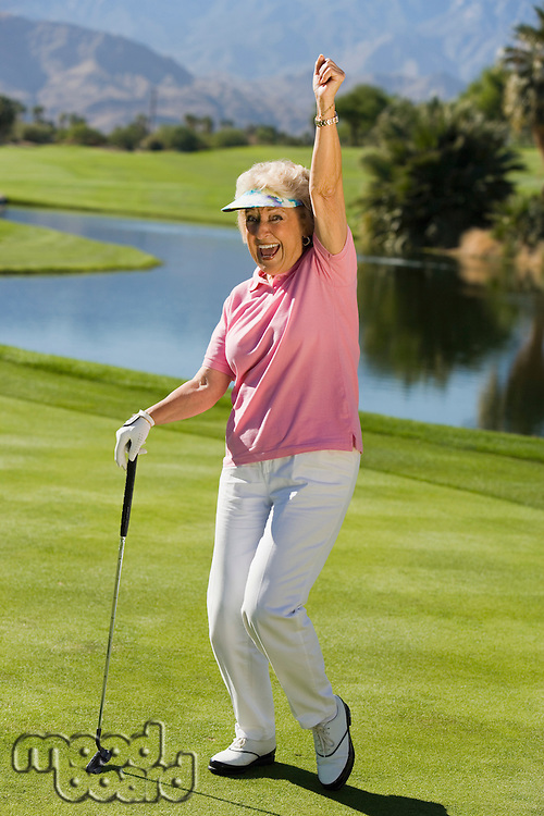 Woman gesturing on golf course (portrait)
