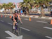 Triathlon competition, Female competitor on a bicycle