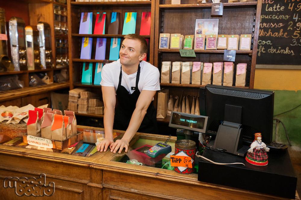 Portrait of confident salesperson in coffee store