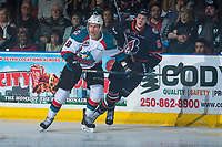 KELOWNA, CANADA - MARCH 31: Carsen Twarynski #18 of the Kelowna Rockets stick checks Dallas Valentine #6 of the Kamloops Blazers on March 31, 2017 at Prospera Place in Kelowna, British Columbia, Canada.  (Photo by Marissa Baecker/Shoot the Breeze)  *** Local Caption ***