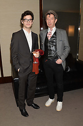 """Left to right, ADAM UROSEVIC and DUGGIE FILEDS at a private screening Of """"The Gun, The Cake and The Butterfly"""" hosted by Amanda Eliasch at The Bulgari Hotel, 171 Knightsbridge, London on 24th March 2014."""