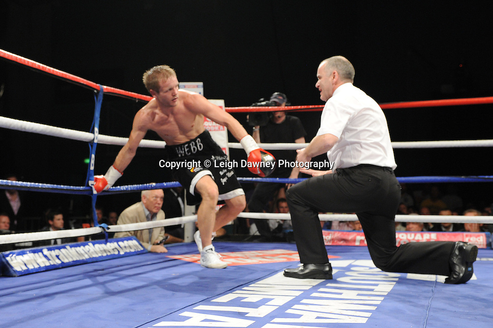 Sam Webb knocked down by Prince Arron who then went on to defeat Sam for the British Light middleweight title at Medway Park, Gillingham,13th May 2011. Frank Maloney Promotions. Photo credit © Leigh Dawney.