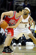 Apr 27, 2010; Cleveland, OH, USA; Cleveland Cavaliers guard Mo Williams (2) defends against Chicago Bulls guard Kirk Hinrich during the first period in game five in the first round of the 2010 NBA playoffs at Quicken Loans Arena.  Mandatory Credit: Jason Miller-US PRESSWIRE