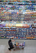 Elevated view of a shopper in an Israeli supermarket