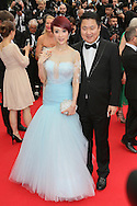 "CANNES, FRANCE - MAY 14:   Jin Qiaoqiao and her husband Dong Yu attend the opening ceremony and ""Grace of Monaco"" premiere at the 67th Annual Cannes Film Festival on May 14, 2014 in Cannes, France.  (Photo by Tony Barson/FilmMagic)"