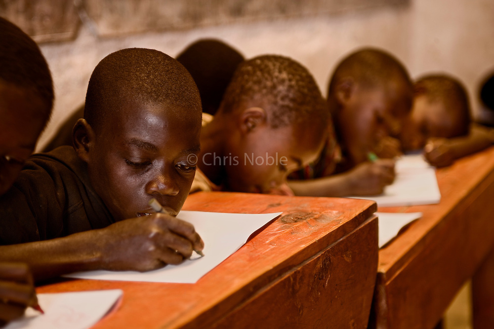 Village boys in an overcrowded classroom in the Genocide survivors village of Rugerero Rwanda.