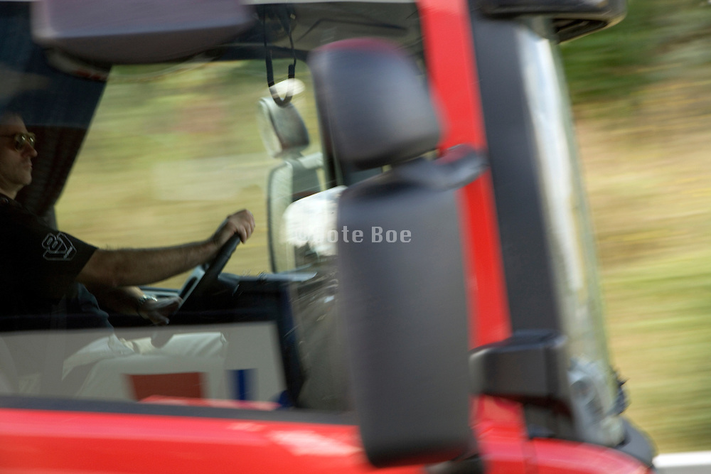 truck driver in his cabin while driving