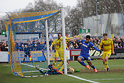 Oxford United goalkeeper Benjamin Buchel denies Lyle Taylor of AFC Wimbledon  during the Sky Bet League 2 match between AFC Wimbledon and Oxford United at the Cherry Red Records Stadium, Kingston, England on 27 February 2016. Photo by David Vokes.