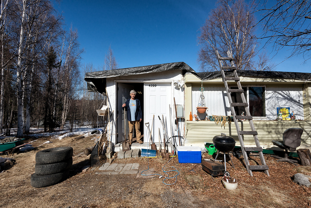"""While traveling the road from Fairbanks to Chena hot springs I saw this man out in his yard working and turned around to ask if I could make a portrait. He readily agreed, picked up a shovel and gave it the American Gothic look, so I'll call it """"Alaskan Gothic."""""""