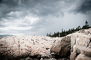 A storm roles in over the cliffs along the Schoodic Peninsula of Acadia National Park.
