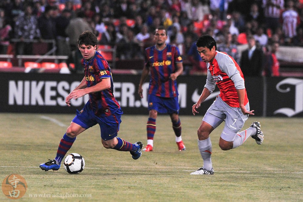 August 8, 2009; San Francisco, CA, USA; FC Barcelona forward Lionel Messi (10, left) controls the ball against Chivas de Guadalajara midfielder Gonzalo Pineda (7) during the first half in the Night of Champions international friendly contest at Candlestick Park.