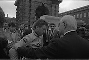 Nissan International Cycle Race..1986..01.10.1986..10.01.1986..1st October 1986..The Nissan Classic began today from Trinity College,Dublin. The offical race starter was The Taoiseach,Dr Garrett FitzGerald TD. He was accompanied by the Minister for Sport,Mr Sean Barrett TD..Sean Kelly was returning to defend his title but his opposition included Greg LeMond, the 1983 world champion and the winner of the Tour de France of the previous July. Roche was out due to his injured leg. Adri van der Poel was back with 1980 Tour de France winner and 1985 world champion Joop Zoetemelk. Teun van Vliet was back too. The winner of the green jersey of the Tour de France that July, Eric Vanderaerden was there as well as Australians Phil Anderson and Alan Peiper as well the Scottish cyclist Robert Millar...Image of Sean Kelly, in his Guinness/Kas race attire,getting instructions before the race