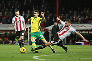 Brentford defender Harlee Dean (6) tackling Norwich City midfielder Robbie Brady (12) during the EFL Sky Bet Championship match between Brentford and Norwich City at Griffin Park, London, England on 31 December 2016. Photo by Matthew Redman.