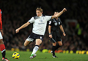 Roman Pavlyuchenko shoots during the Barclays Premier League match between Manchester United and Tottenham Hotspur at Old Trafford on October 30, 2010 in Manchester, England.