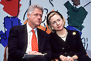 US President Bill Clinton talks with first lady Hillary Clinton during an event at National Children's Hospital February 18, 1998 in Washington, DC.