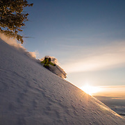 Forrest Jillson skis sunrise powder in Wyoming.
