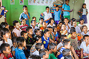 04 MARCH 2014 - MAE SOT, TAK, THAILAND: Students in a classroom at the Sky Blue School. There are approximately 140 students in the Sky Blue School, north of Mae Sot. The school is next to the main landfill for Mae Sot and serves the children of the people who work in the landfill. The school relies on grants and donations from Non Governmental Organizations (NGOs). Reforms in Myanmar have alllowed NGOs to operate in Myanmar, as a result many NGOs are shifting resources to operations in Myanmar, leaving Burmese migrants and refugees in Thailand vulnerable. The Sky Blue School was not able to pay its teachers for three months during the current school year because money promised by a NGO wasn't delivered when the NGO started to support schools in Burma. The school got an emergency grant from the Burma Migrant Teachers' Association and has since been able to pay the teachers.    PHOTO BY JACK KURTZ