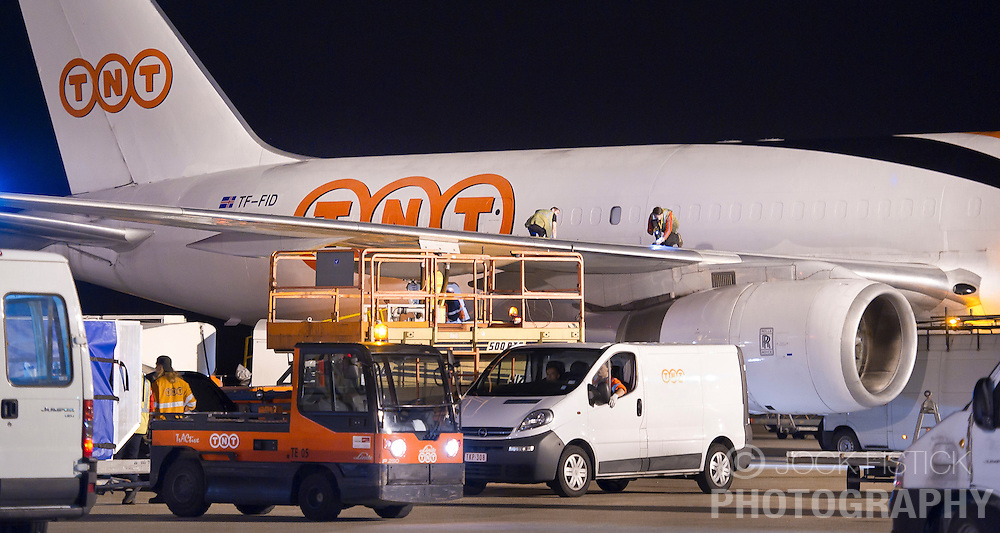 A TNT Express Worldwide S.A. cargo plane is unloaded, serviced, and reloaded, at the Liège Airport in Grâce-Hollogne, Belgium, on Friday July 23, 2010. Approximately  90,000 packages move through TNT's main European hub every night. (Photo © Jock Fistick)
