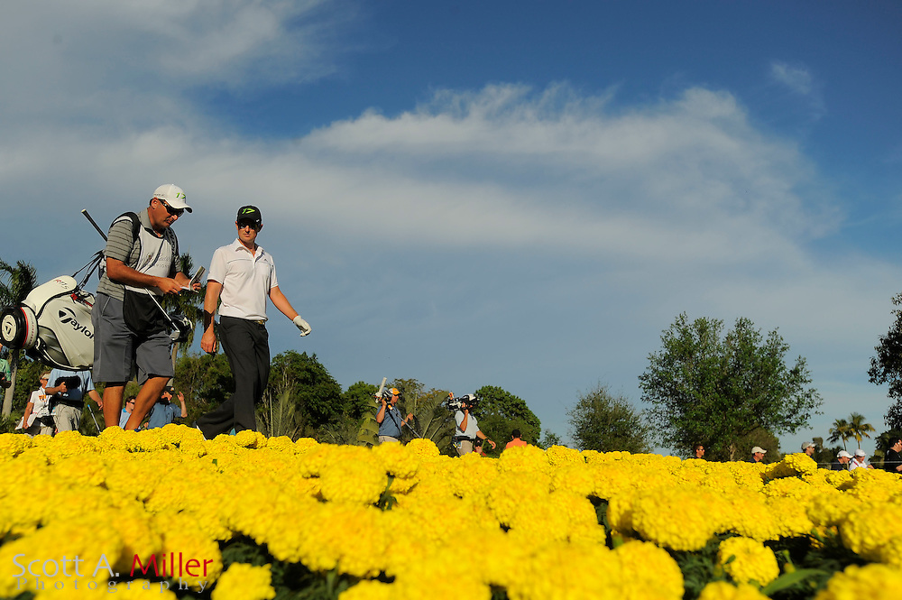 Justin Rose and his caddie Mark Fultcher during the third round of the World Golf Championship Cadillac Championship on the TPC Blue Monster Course at Doral Golf Resort And Spa on March 10, 2012 in Doral, Fla. ..©2012 Scott A. Miller.