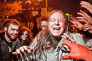 "Oct. 30, 2009 -- PHOENIX, AZ: JEANNIE RANKIN is attacked by ravenous zombies during the Zombie Walk in Phoenix Friday. About 200 people participated in the first ""Zombie Walk"" in Phoenix, AZ, Friday night. The Zombies walked through downtown Phoenix ""attacking"" willing victims and mixing with folks going to the theatre and downtown sports venues.  Photo by Jack Kurtz"