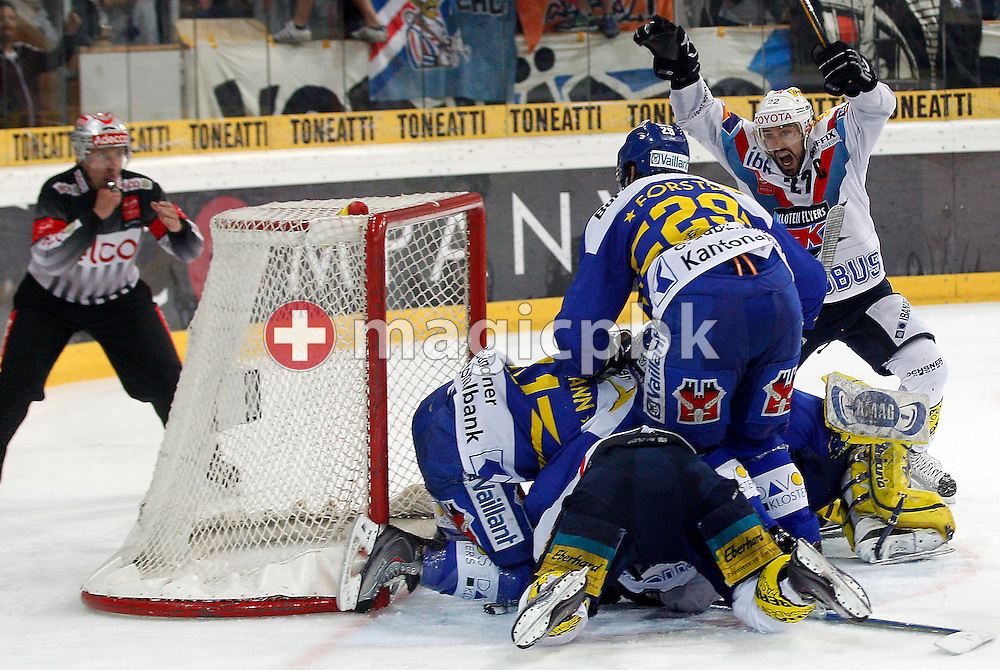 Kloten Flyers forward Victor STANCESCU (back) jubilates after teammate Michael Liniger (C front bottom) scored the equalizer to the score of 3-3 against HC Davos goaltender Leonardo Genoni (C back bottom) during ice hockey game five of the Swiss National League A Playoff Final between HC Davos (HCD) and Kloten Flyers (aka EHC Kloten) held at the Vaillant Arena in Davos, Switzerland, Saturday, April 9, 2011. (Photo by Patrick B. Kraemer / MAGICPBK)