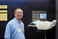 GILROY CHOW, of Clarksdale, Mississippi, is at a Summer of '69 Celebration Event held at the Long Island Cradle of Aviation Museum, on the 45th Anniversary of NASA Apollo 11 LEM, Lunar Excursion Module, landing on the moon July 20, 1969. Chow helped build, assemble and test all Lunar Modules, LM 1 through LM 15, Apollo 7 through Apollo 17, from 1966 - 1973, and was attending the reunion of former Northrop Grumman Aerospace Corporation employees. He is standing next to a model of the Lifting Body, an early concept reusable flight vehicle.
