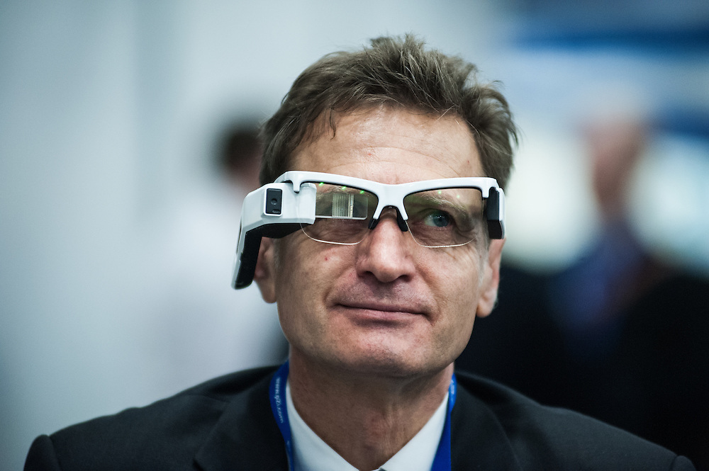 London, UK - 17 March 2014:  a man wears smart glasses ORA by Optinvent at the Wearable Technology Conference at Olympia in London