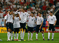 Photo: Glyn Thomas.<br />England v Portugal. Quarter Finals, FIFA World Cup 2006. 01/07/2006.<br /> England's players are dejected as they lose on penalties.