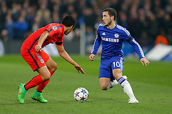 Eden Hazard of Chelsea is challenged by Marquinhos of Paris Saint-Germain - Photo mandatory by-line: Rogan Thomson/JMP - 07966 386802 - 11/03/2015 - SPORT - FOOTBALL - London, England - Stamford Bridge - Chelsea v Paris Saint-Germain - UEFA Champions League Round of 16 Second Leg.