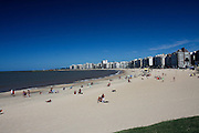 Montevideo, Uruguay - Locals enjoy the sun on the beach of the river of Plata