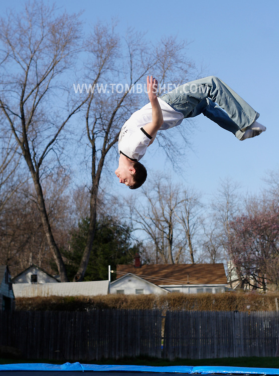 Middletown, NY - A young man looks down as he flips through the air on a trampoline on April 21, 2007.