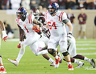 Mississippi Rebels wide receiver Laquon Treadwell (1) is tackled by Texas A&M Aggies defensive back Deshazor Everett (29) in College Station, Texas on Saturday, October 11, 2014.