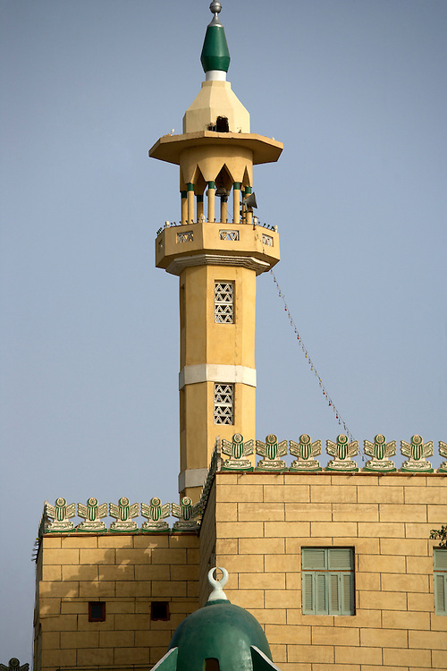 Minaret of mosque on Nile River.Aswan, Egypt