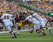 September 07 2013: Iowa Hawkeyes wide receiver Kevonte Martin-Manley (11) is hit by Missouri State Bears safety Caleb Schaffitzel (34) and Missouri State Bears linebacker Dylan Cole (31) as Missouri State Bears cornerback Sybhrian Berry (25) closes in during the first quarter of the NCAA football game between the Missouri State Bears and the Iowa Hawkeyes at Kinnick Stadium in Iowa City, Iowa on September 7, 2013. Iowa defeated Missouri State 28-14.