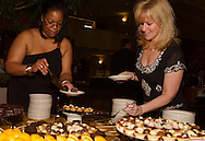 "Djuana Brown-Jennings of Trotwood (left) and Tina Hohl of Kettering stop by the dessert table during ""Be a Star,"" the 21st Annual Artemis Center Gala, at Sinclair College's David H. Ponitz Center, Saturday, February 5, 2011."