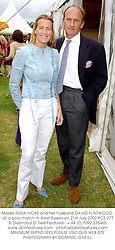 Model INDIA HICKS and her husband DAVID FLINTWOOD, at a polo match in West Sussex on 21st July 2002.PCE 277