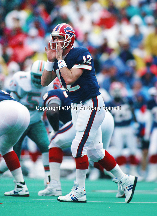 Buffalo Bills quarterback Jim Kelly (12) calls an audible during the NFL football game against the Miami Dolphins on Sept. 26, 1993 in Orchard Park, N.Y. The Dolphins won the game 22-13. (©Paul Anthony Spinelli)