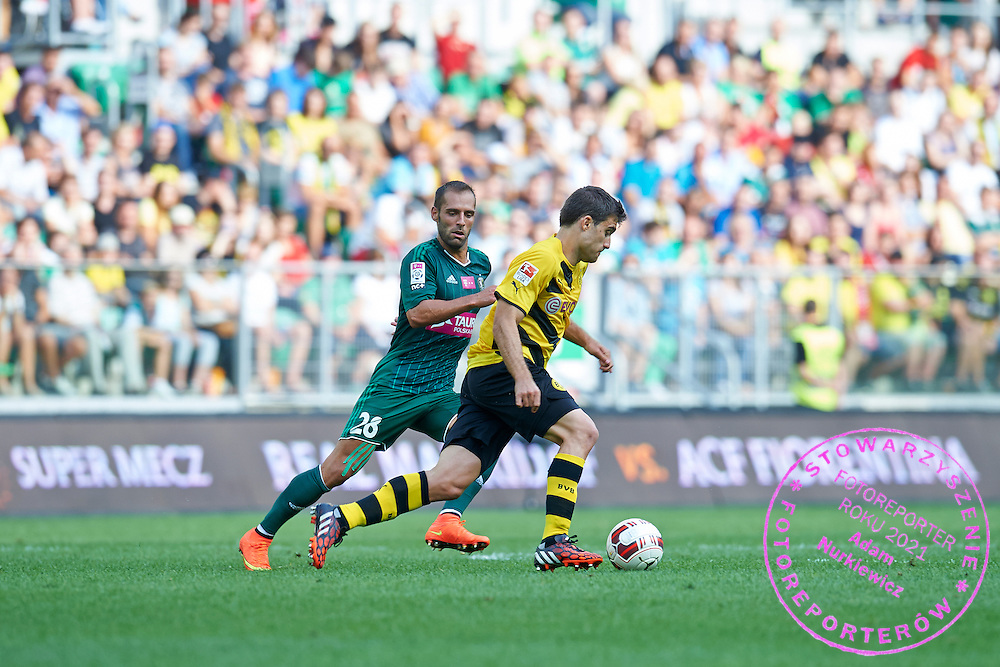 Sokratis Papastathopoulos of Dorussia Dortmund controls the ball during international friendly soccer match between WKS Slask Wroclaw and BVB Borussia Dortmund on Municipal Stadium in Wroclaw, Poland.<br /> <br /> Poland, Wroclaw, August 6, 2014<br /> <br /> Picture also available in RAW (NEF) or TIFF format on special request.<br /> <br /> For editorial use only. Any commercial or promotional use requires permission.<br /> <br /> Mandatory credit:<br /> Photo by &copy; Adam Nurkiewicz / Mediasport