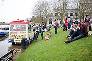 © Licensed to London News Pictures. 30/03/2014. Richmond, UK. An ice cream carries on serving whilst stood in floodwater. The high tide on the River Thames causing flooding in Richmond this afternoon 30th March 2014. Photo credit : Stephen Simpson/LNP