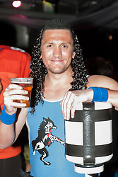 "The Hubs, Hallam Union, Paternoster Row plays host to Sheffield's biggest Fancy Dress Ball. More than 900 people in fancy dress to raise money for Cancer Research on Saturday night The Gladiators ""Wolf"" enjoys a pint..6 April  2013.Image © Paul David Drabble"